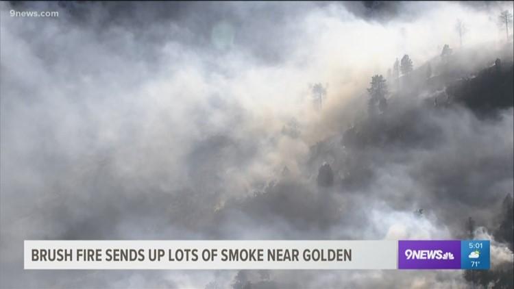 Wildfire burns near Golden
