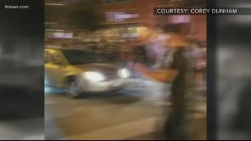 Denver police search for car that hit 2 in LoDo