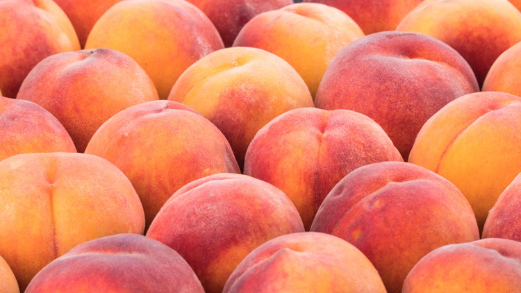 Ripe peach fruit background, close up. Selective focus peaches