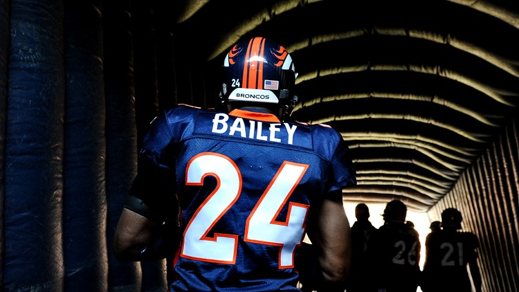 945ceaa0733 Cornerback Champ Bailey  24 of the Denver Broncos takes the field against  the New England Patriots at Sports Authority Field at Mile High on December  18