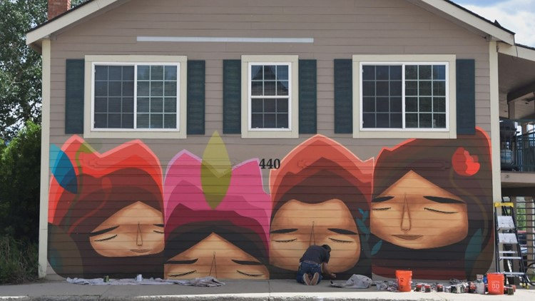 Artist says Granby residents have complained about murals painted on buildings for street art festival