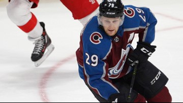 MacKinnon scores in overtime, Avs defeat Red Wings