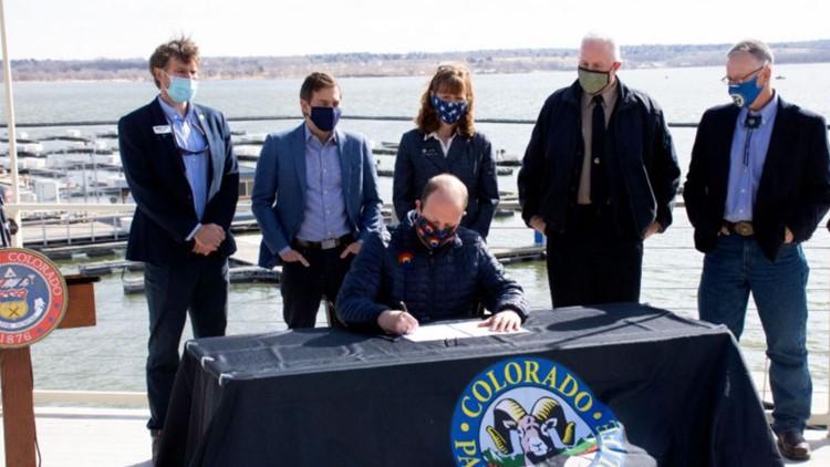 Gov. Polis signs bills funding state parks, wildfire efforts, marijuana industry equity