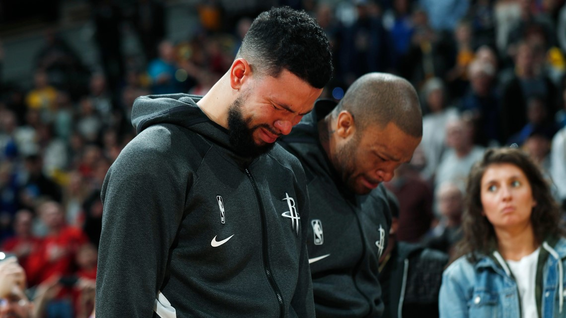 Nuggets beat Rockets 117-110 on somber day