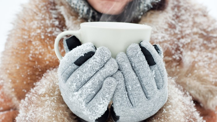 Woman holding a mug to get warm in winter winter christmas festival hot cocoa chocolate