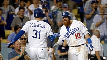 Pederson's 2 HRs give Dodgers NL record in 7-3 win over Rox