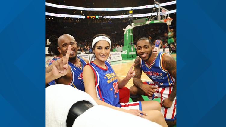 Natasha Verma with the Harlem Globetrotters.
