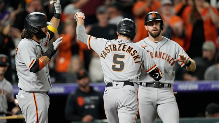 Giants top Rockies 7-2 for 100th win, hold onto NL West lead