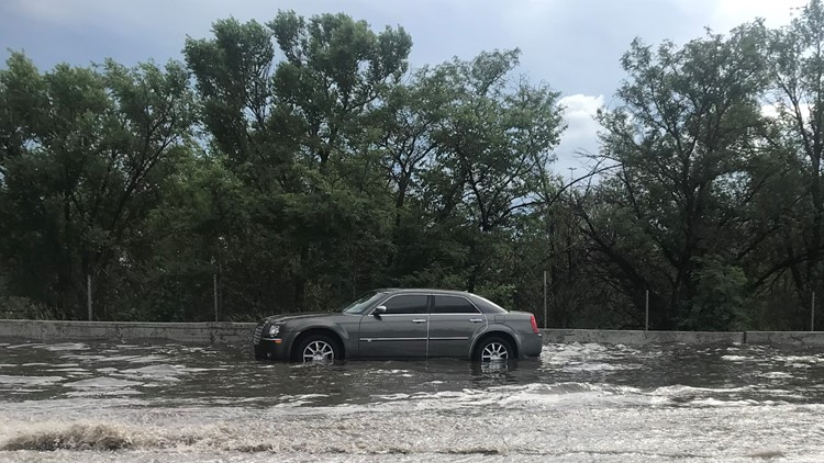 Car in flooding on I-25