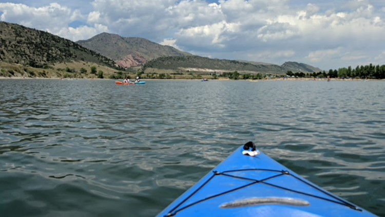 Kayaking Big Soda lake with views of Red Rocks in the distance.