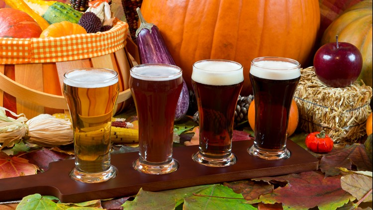 oktoberfest beer flight of four samples with fall seasonal decoration pumpkins pumpkin beer