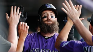 Rockies outslug Padres in wild game at Coors Field
