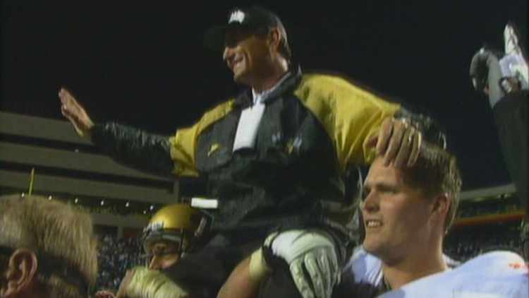 """Coach Bill McCartney is hoisted in the air after what's known as the """"Miracle in Michigan,"""" the 1994 game when the Buffs beat the Wolverines with only seconds remaining."""