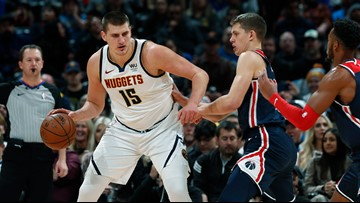 Jokic, Grant lead Nuggets to a 117-104 win over Wizards