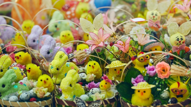 spring craft show fair baskets filled with handmade figurines of Easter bunnies, chicks and floral ornaments on display in the gifts and crafts market.