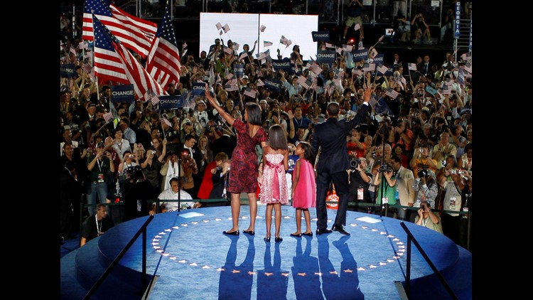 Michelle Obama, Malia Obama, Sasha Obama and U.S. Sen. Barack Obama (D-IL) stand on stage after he accepted the Democratic presidential nomination at Invesco Field at Mile High at the 2008 Democratic National Convention (DNC) August 28, 2008