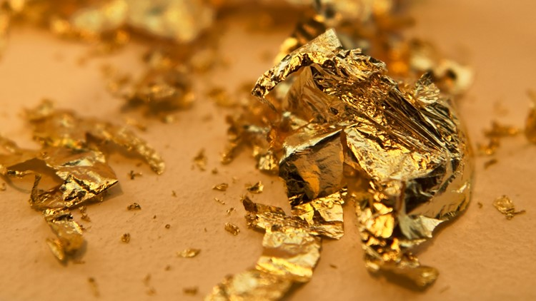 riven gold leaves and flakes in warm toned ambiance gold and treasure show mineral gem