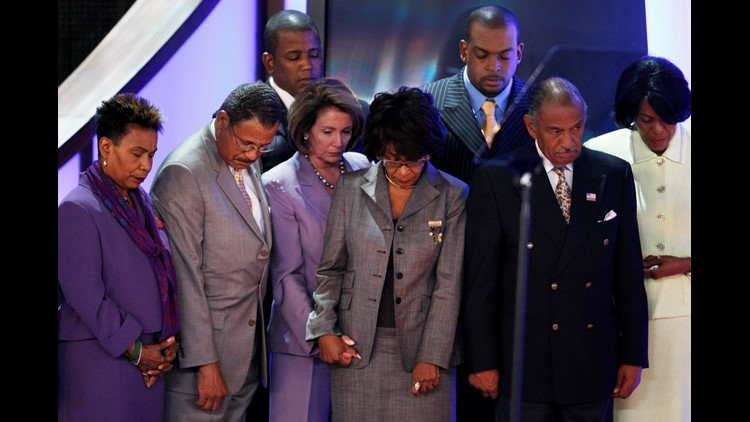 """Speaker of the House Nancy Pelosi (D-CA) (4th L) and members of the Congressional Black Caucus bow their heads during an """"in memoriam"""" presentation on day two of the Democratic National Convention (DNC) at the Pepsi Center August 26, 2008"""
