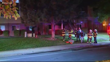 Woman dies after being pulled from Littleton apartment fire