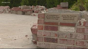 Brick memorial pillars found smashed at Aurora church