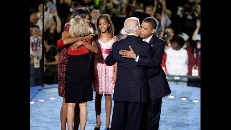 Democratic U.S. Vice-Presidential nominee Joe Biden (D-DE) (2nd-R) and Democratic U.S. Presidential nominee Sen. Barack Obama (D-IL) (R) embrace, while Malia Obama watches Jill Biden (2nd-L) and Michelle Obama (L) embrace as they all stand on stage