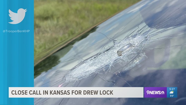 Broncos QB Drew Lock poses with troopers in Kansas after lug-nut nearly goes through windshield