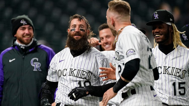 Blackmon's 3-run HR caps comeback as Rockies, Giants split