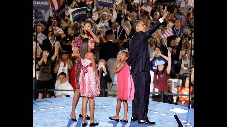 (L-R) Michelle Obama, Malia Obama, Sasha Obama and U.S. Sen. Barack Obama (D-IL) stand on stage after he accepted the Democratic presidential nomination at Invesco Field at Mile High at the 2008 Democratic National Convention (DNC