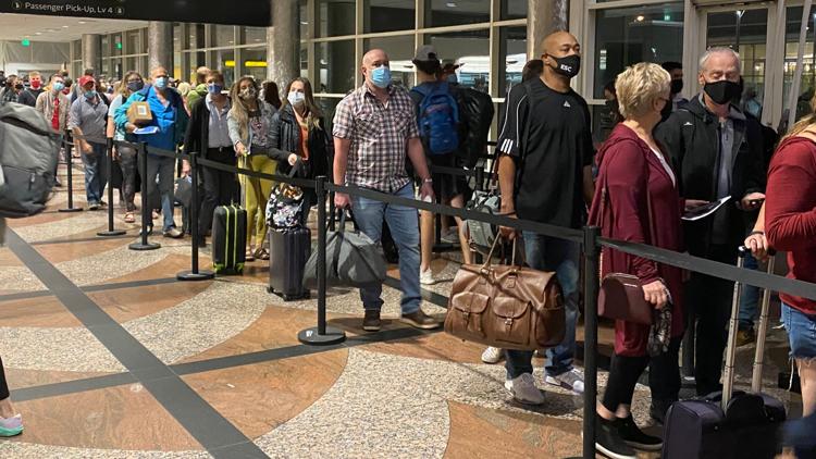 Long security lines at DIA Friday morning