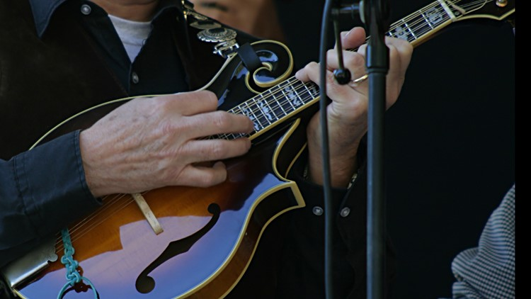 A man playing a mandolin in a bluegrass band banjo