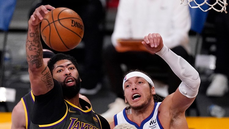 Davis scores 25 as short-handed Lakers defeat Nuggets