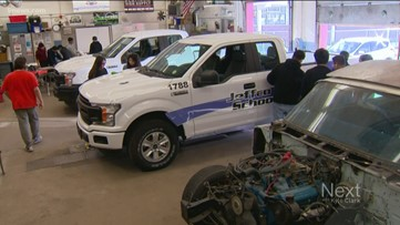 Students learn lessons, put money back into program by wrapping cars for Jeffco Schools