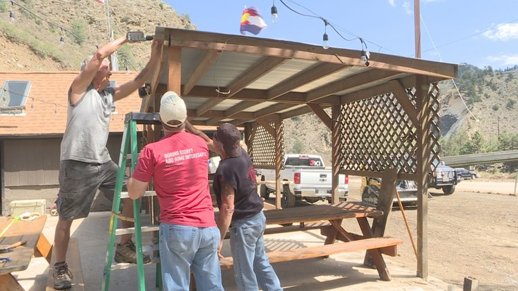 Volunteers help business clean up after mudslide