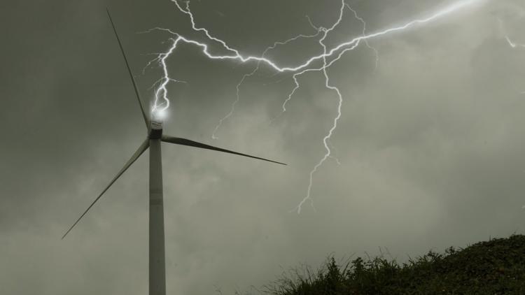 Lightning striking a wind turbine