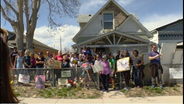 Neighborhood gathers, shows support for pair whose house was vandalized by racist graffiti