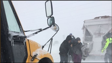 School buses help reunite drivers with cars they abandoned during Denver's blizzard