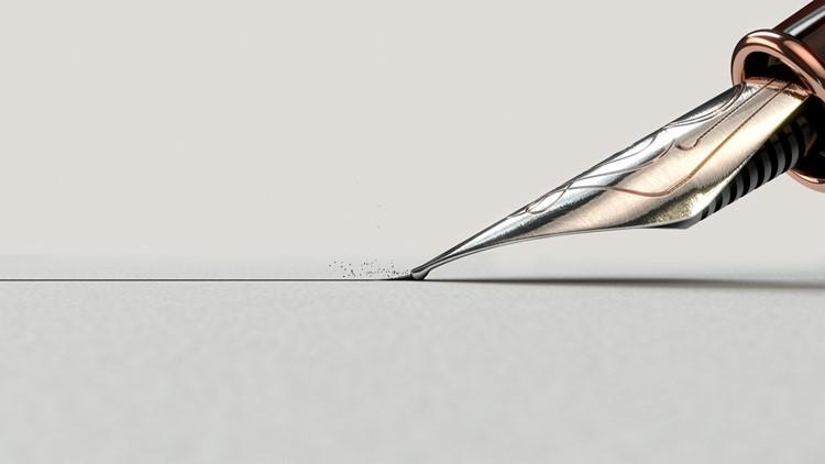 A closeup view of an ornate metal nib of an old fountain pen