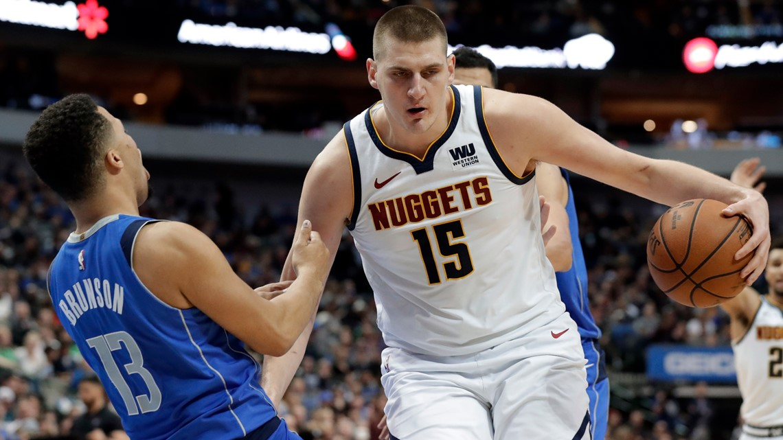Nuggets beat Mavs 114-104 as Doncic sits with sore ankle