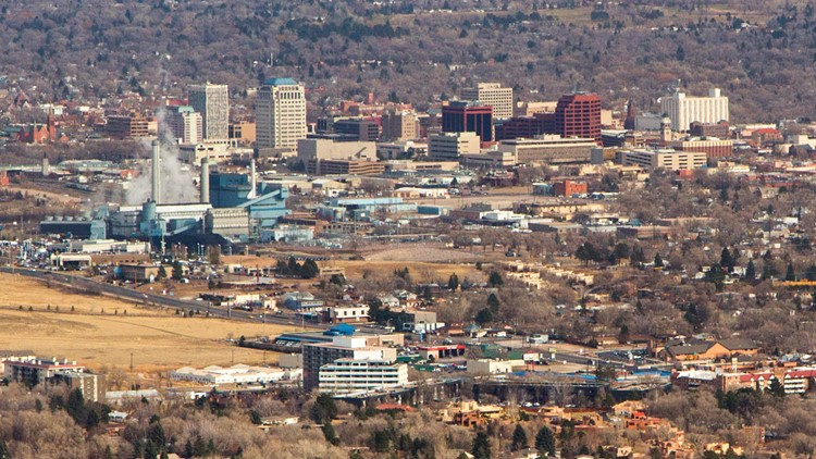 This is a view from Old Stage Road looking at Downtown Colorado Springs, Colorado. The photo was taken in winter with no leaves on the trees