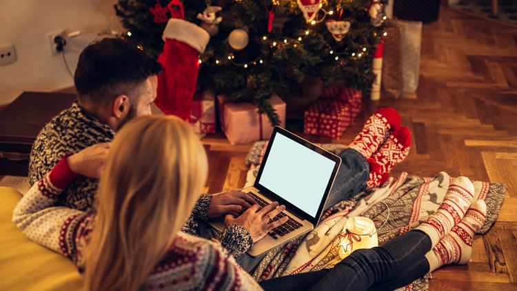 Couple enjoying Christmas mood while surfing the net together movies netflix and chill