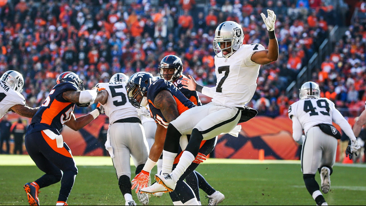 Marquette King of the Oakland Raiders is knocked back by Todd Davis on December 13, 2015 in Denver, Colorado.
