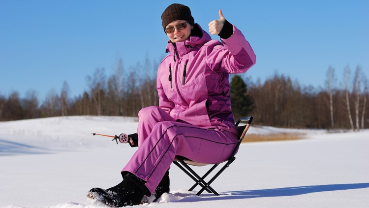 Young girl on winter fishing 2