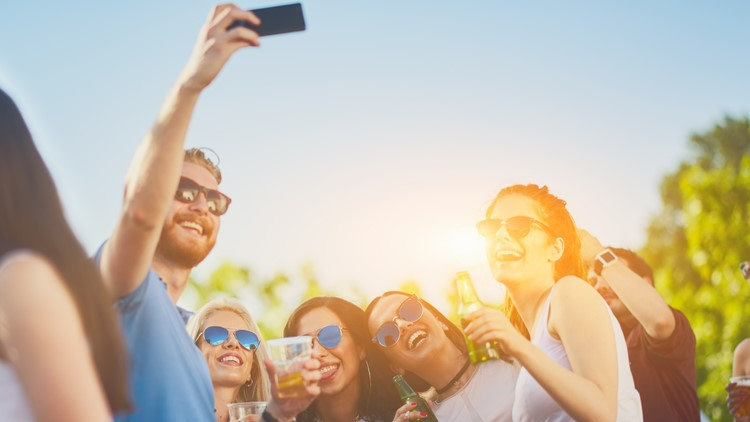 summer music concert festival    Friends taking selfie at party outdoors