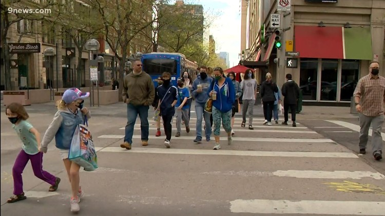 WATCH: As restrictions ease, life in Denver begins to look more like normal