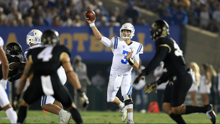 Josh Rosen passes as Dante Wigley of the Colorado Buffaloes defends during the first half of a game at the Rose Bowl on September 30, 2017 in Pasadena, California. Photo by Sean M. Haffey/Getty Images.