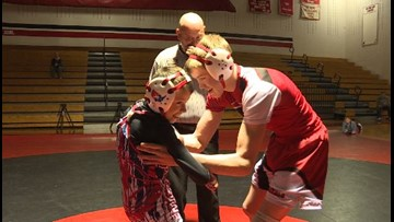 Wrestler with cerebral palsy wins match against cousin