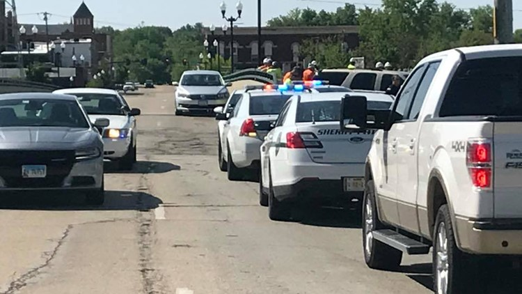 A 19-year-old suspected gunman was shot by a school resource officer outside a high school in Dixon, Ill. after the suspect opened fire inside the school building, police said.