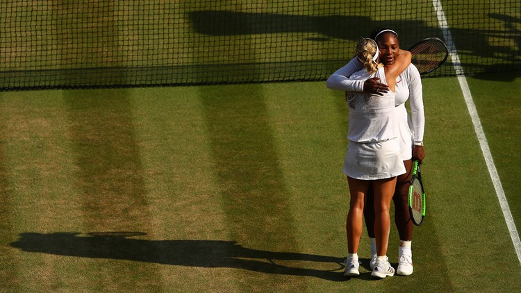 Angelique Kerber of Germany (L) embraces Serena Williams of The United States after the Ladies' Singles final on day twelve of the Wimbledon Lawn Tennis Championships at All England Lawn Tennis and Croquet Club on July 14, 2018 in London, England.