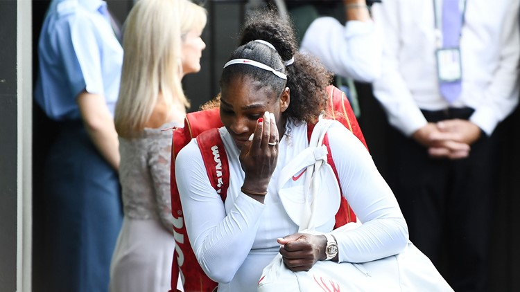 Serena Williams of The United States leaves Centre Court after losing to Angelique Kerber of Germany in the Ladies' Singles final on day twelve of the Wimbledon Lawn Tennis Championships on July 14, 2018 in London, England.