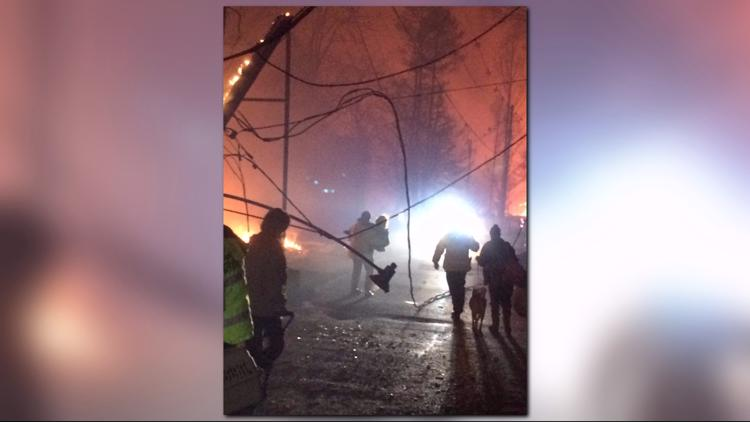 Tennessee Highway Patrol troopers work to remove those who were trapped by flames on Thursday, Nov. 29, 2016